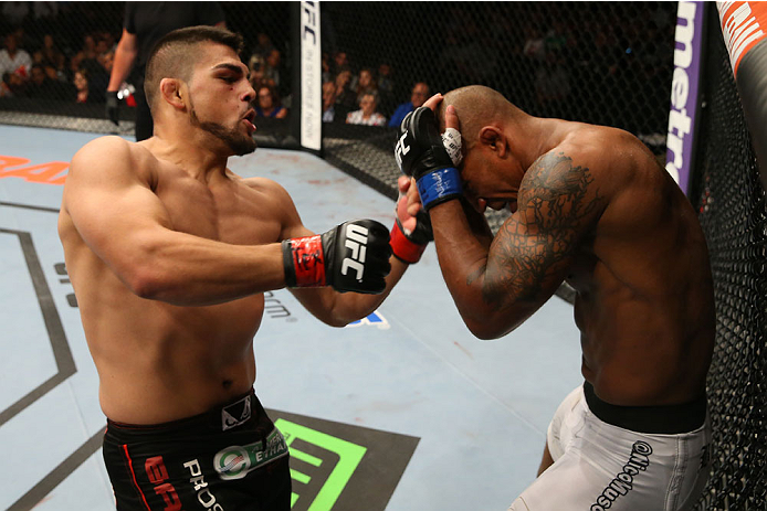 SAN ANTONIO, TX - JUNE 28:  (L-R) Kelvin Gastelum punches Nico Musoke in their welterweight bout at the AT&T Center on June 28, 2014 in San Antonio, Texas. (Photo by Ed Mulholland/Zuffa LLC/Zuffa LLC via Getty Images)