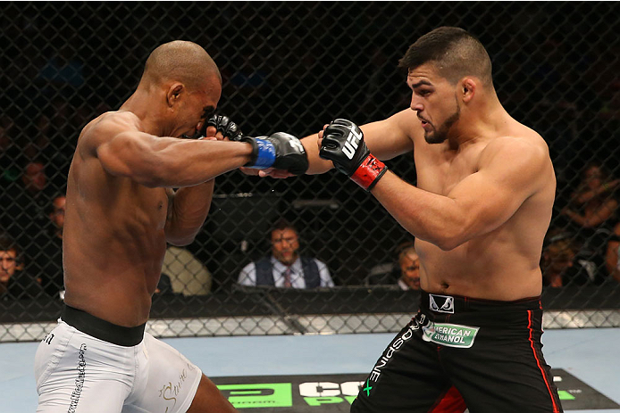 SAN ANTONIO, TX - JUNE 28:  (R-L) Kelvin Gastelum punches Nico Musoke in their welterweight bout at the AT&T Center on June 28, 2014 in San Antonio, Texas. (Photo by Ed Mulholland/Zuffa LLC/Zuffa LLC via Getty Images)