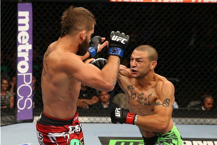 SAN ANTONIO, TX - JUNE 28:  (R-L) Cub Swanson punches Jeremy Stephens in their featherweight bout at the AT&T Center on June 28, 2014 in San Antonio, Texas. (Photo by Ed Mulholland/Zuffa LLC/Zuffa LLC via Getty Images)