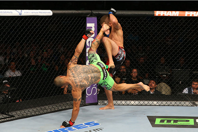 SAN ANTONIO, TX - JUNE 28:  Cub Swanson (green shorts) kicks Jeremy Stephens in their featherweight bout at the AT&T Center on June 28, 2014 in San Antonio, Texas. (Photo by Ed Mulholland/Zuffa LLC/Zuffa LLC via Getty Images)