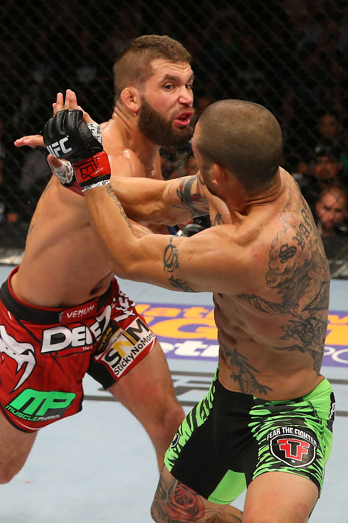 SAN ANTONIO, TX - JUNE 28:  Jeremy Stephens (top) punches Cub Swanson in their featherweight bout at the AT&T Center on June 28, 2014 in San Antonio, Texas. (Photo by Ed Mulholland/Zuffa LLC/Zuffa LLC via Getty Images)