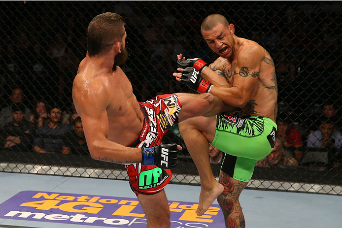SAN ANTONIO, TX - JUNE 28:  (L-R) Jeremy Stephens kicks Cub Swanson in their featherweight bout at the AT&T Center on June 28, 2014 in San Antonio, Texas. (Photo by Ed Mulholland/Zuffa LLC/Zuffa LLC via Getty Images)