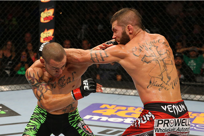 SAN ANTONIO, TX - JUNE 28:  (L-R) Cub Swanson punches Jeremy Stephens in their featherweight bout at the AT&T Center on June 28, 2014 in San Antonio, Texas. (Photo by Ed Mulholland/Zuffa LLC/Zuffa LLC via Getty Images)