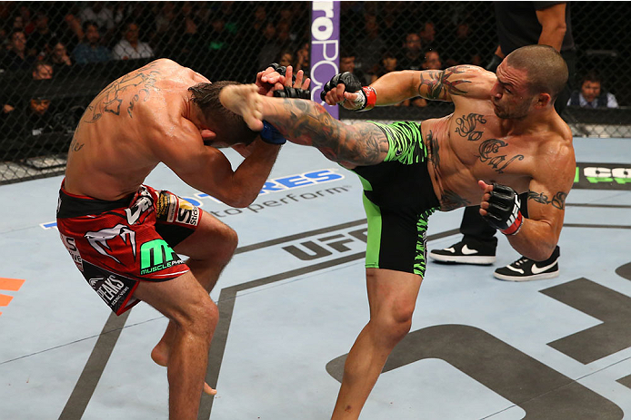 SAN ANTONIO, TX - JUNE 28:  (R-L) Cub Swanson kicks Jeremy Stephens in their featherweight bout at the AT&T Center on June 28, 2014 in San Antonio, Texas. (Photo by Ed Mulholland/Zuffa LLC/Zuffa LLC via Getty Images)