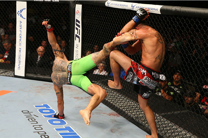 SAN ANTONIO, TX - JUNE 28:  (L-R) Cub Swanson kicks Jeremy Stephens in their featherweight bout at the AT&T Center on June 28, 2014 in San Antonio, Texas. (Photo by Ed Mulholland/Zuffa LLC/Zuffa LLC via Getty Images)