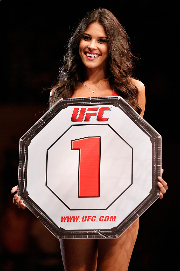 NATAL, BRAZIL - MARCH 23:  UFC Octagon Girl Camila Rodrigues de Oliveira introduces a round during the UFC Fight Night event at Ginasio Nelio Dias on March 23, 2014 in Natal, Brazil. (Photo by Josh Hedges/Zuffa LLC/Zuffa LLC via Getty Images)