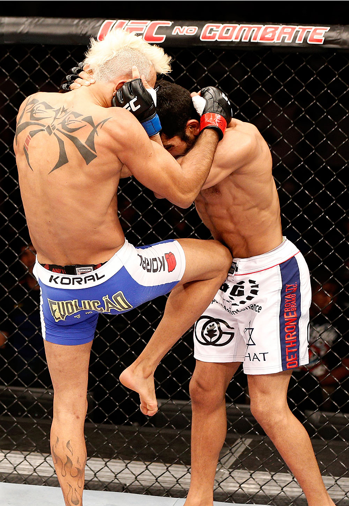 """NATAL, BRAZIL - MARCH 23:  (L-R) Godofredo """"Pepey"""" Castro knees Noad Lahat in their featherweight bout during the UFC Fight Night event at Ginasio Nelio Dias on March 23, 2014 in Natal, Brazil. (Photo by Josh Hedges/Zuffa LLC/Zuffa LLC via Getty Images)"""