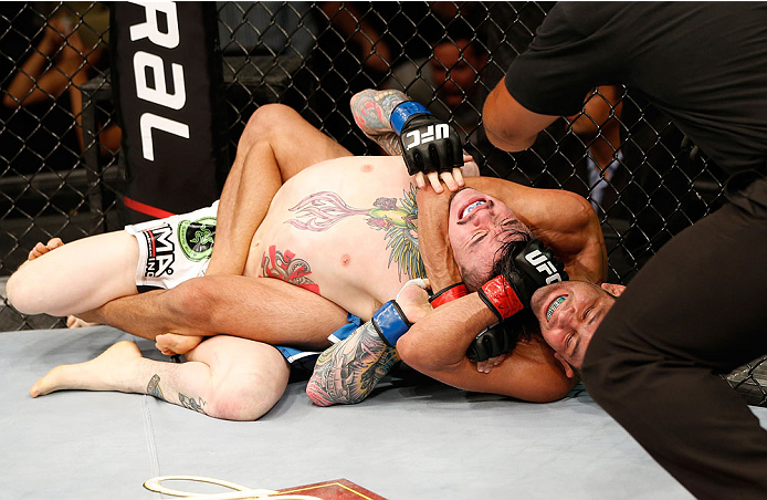 NATAL, BRAZIL - MARCH 23:  (R-L) Jussier Formiga secures a rear choke submission against Scott Jorgensen in their flyweight bout during the UFC Fight Night event at Ginasio Nelio Dias on March 23, 2014 in Natal, Brazil. (Photo by Josh Hedges/Zuffa LLC/Zuf