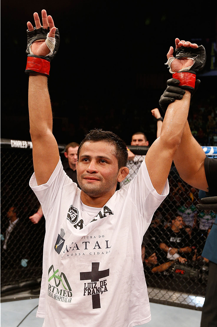 NATAL, BRAZIL - MARCH 23:  Jussier Formiga reacts after his submission victory over Scott Jorgensen in their flyweight bout during the UFC Fight Night event at Ginasio Nelio Dias on March 23, 2014 in Natal, Brazil. (Photo by Josh Hedges/Zuffa LLC/Zuffa LL