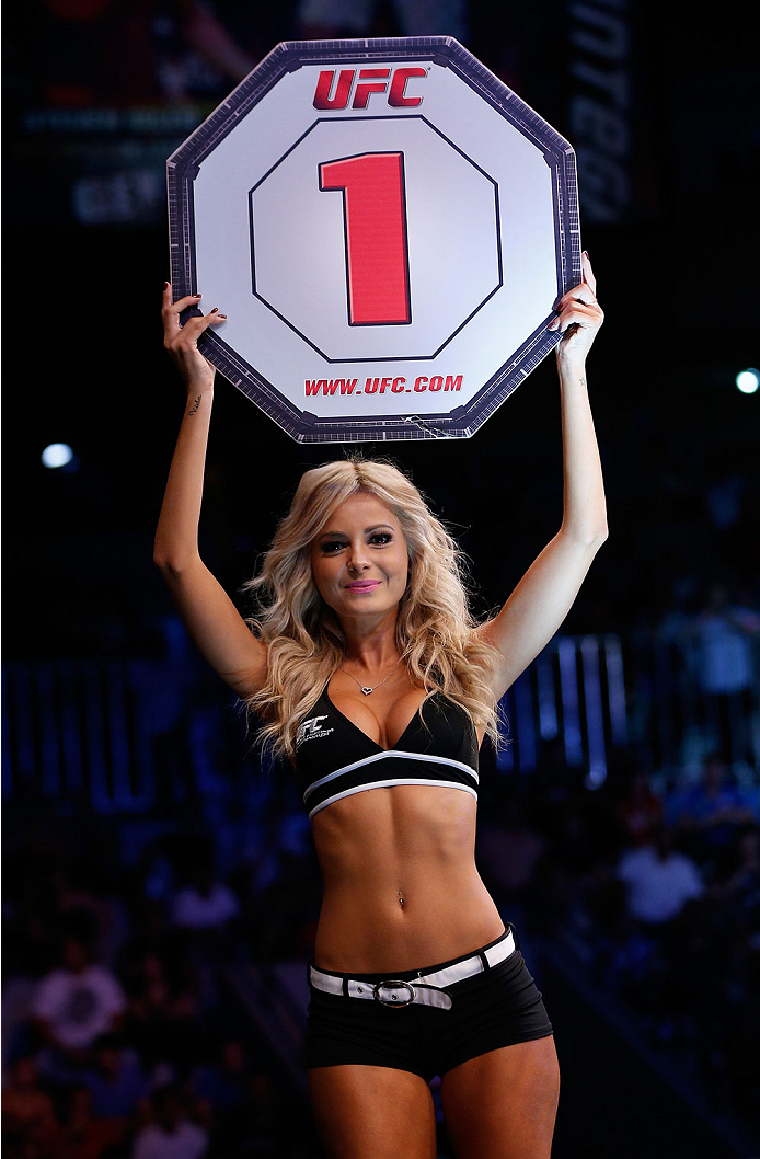 NATAL, BRAZIL - MARCH 23: UFC Octagon Girl Jhenny Andrade introduces a round during the UFC Fight Night event at Ginasio Nelio Dias on March 23, 2014 in Natal, Brazil. (Photo by Josh Hedges/Zuffa LLC/Zuffa LLC via Getty Images)