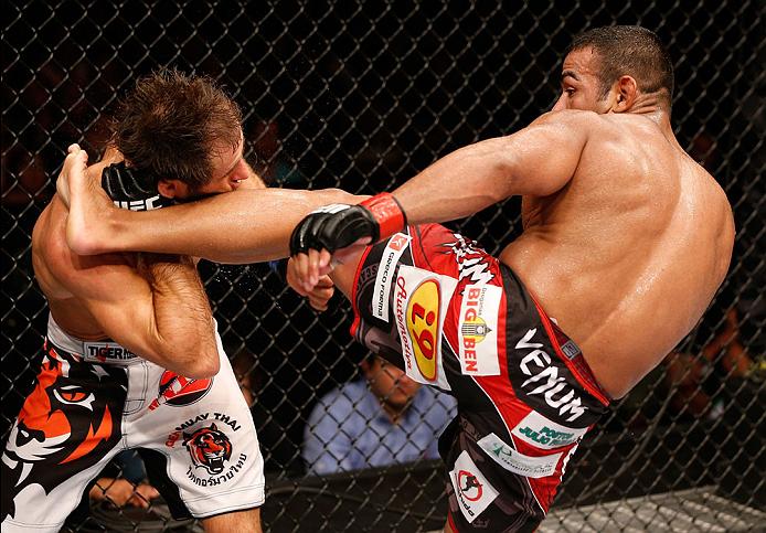 NATAL, BRAZIL - MARCH 23:  (R-L) Michel Prazeres kicks Maribek Taisumov in their lightweight bout during the UFC Fight Night event at Ginasio Nelio Dias on March 23, 2014 in Natal, Brazil. (Photo by Josh Hedges/Zuffa LLC/Zuffa LLC via Getty Images)