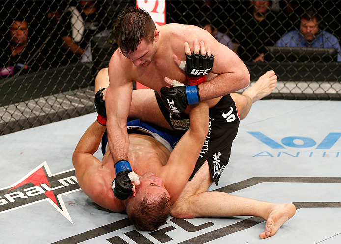 NATAL, BRAZIL - MARCH 23:  Gian Villante (top) punches Fabio Maldonado in their light heavyweight bout during the UFC Fight Night event at Ginasio Nelio Dias on March 23, 2014 in Natal, Brazil. (Photo by Josh Hedges/Zuffa LLC/Zuffa LLC via Getty Images)