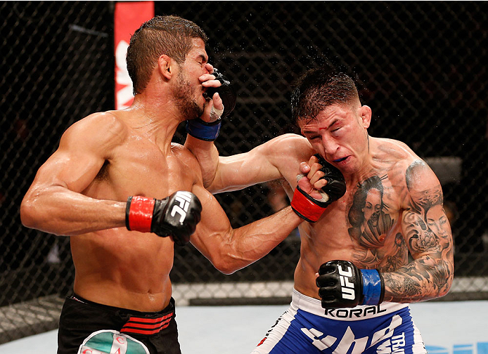 NATAL, BRAZIL - MARCH 23:  (L-R) Leonardo Santos punches Norman Parke in their lightweight bout during the UFC Fight Night event at Ginasio Nelio Dias on March 23, 2014 in Natal, Brazil. (Photo by Josh Hedges/Zuffa LLC/Zuffa LLC via Getty Images)