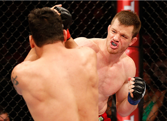 """NATAL, BRAZIL - MARCH 23:  (R-L) CB Dollaway punches Cezar """"Mutante"""" Ferreira in their middleweight bout during the UFC Fight Night event at Ginasio Nelio Dias on March 23, 2014 in Natal, Brazil. (Photo by Josh Hedges/Zuffa LLC/Zuffa LLC via Getty Images)"""