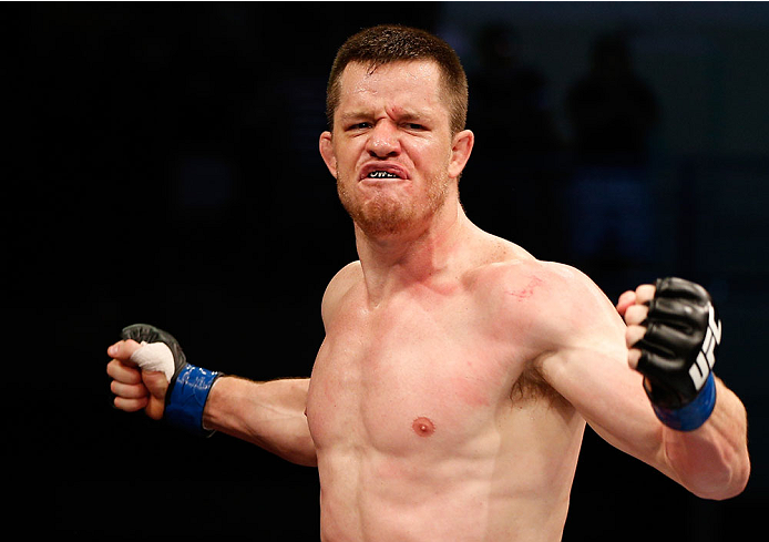 """NATAL, BRAZIL - MARCH 23:  CB Dollaway reacts after his knockout victory over Cezar """"Mutante"""" Ferreira in their middleweight bout during the UFC Fight Night event at Ginasio Nelio Dias on March 23, 2014 in Natal, Brazil. (Photo by Josh Hedges/Zuffa LLC/Zu"""