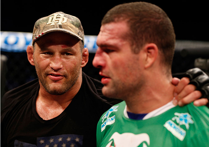 """NATAL, BRAZIL - MARCH 23:  (L-R) Dan Henderson provides words of encouragement for Mauricio """"Shogun"""" Rua after knocking him out in their light heavyweight bout during the UFC Fight Night event at Ginasio Nelio Dias on March 23, 2014 in Natal, Brazil. (Pho"""