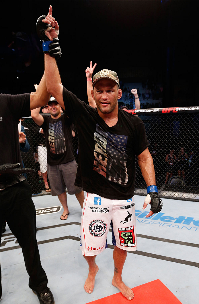"""NATAL, BRAZIL - MARCH 23:  Dan Henderson reacts after knocking out Mauricio """"Shogun"""" Rua in their light heavyweight bout during the UFC Fight Night event at Ginasio Nelio Dias on March 23, 2014 in Natal, Brazil. (Photo by Josh Hedges/Zuffa LLC/Zuffa LLC v"""