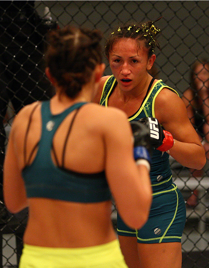LAS VEGAS, NV - AUGUST 14:  (R-L) Team Pettis fighter Carla Esparza circles the cage against team Pettis fighter Jessica Penne during filming of season twenty of The Ultimate Fighter on August 14, 2014 in Las Vegas, Nevada. (Photo by Brandon Magnus/Zuffa