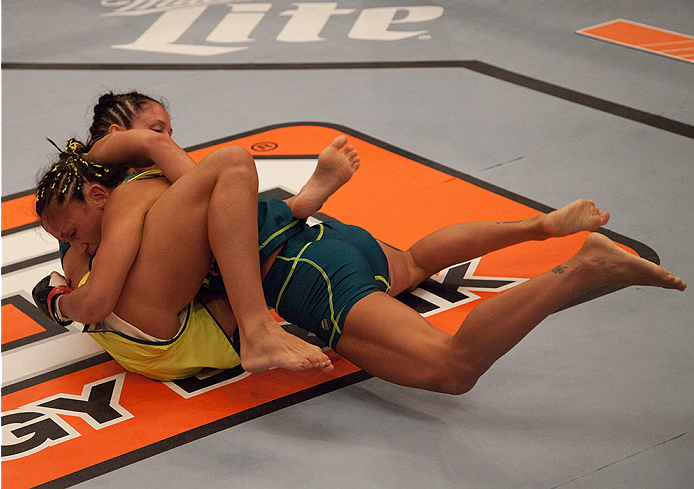 LAS VEGAS, NV - AUGUST 14:  Team Pettis fighter Carla Esparza (top) takes down team Pettis fighter Jessica Penne during filming of season twenty of The Ultimate Fighter on August 14, 2014 in Las Vegas, Nevada. (Photo by Brandon Magnus/Zuffa LLC/Zuffa LLC