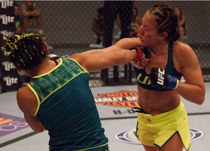 LAS VEGAS, NV - AUGUST 14:  (R-L) Team Pettis fighter Jessica Penne exchanges punches with team Pettis fighter Carla Esparza during filming of season twenty of The Ultimate Fighter on August 14, 2014 in Las Vegas, Nevada. (Photo by Brandon Magnus/Zuffa LL