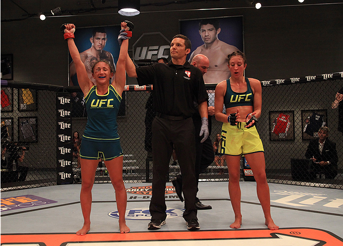 LAS VEGAS, NV - AUGUST 14:  (L-R) Team Pettis fighter Carla Esparza celebrates her win over team Pettis fighter Jessica Penne during filming of season twenty of The Ultimate Fighter on August 14, 2014 in Las Vegas, Nevada. (Photo by Brandon Magnus/Zuffa L