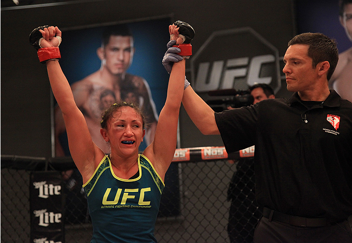 LAS VEGAS, NV - AUGUST 14:  Team Pettis fighter Carla Esparza celebrates her win over team Pettis fighter Jessica Penne during filming of season twenty of The Ultimate Fighter on August 14, 2014 in Las Vegas, Nevada. (Photo by Brandon Magnus/Zuffa LLC/Zuf