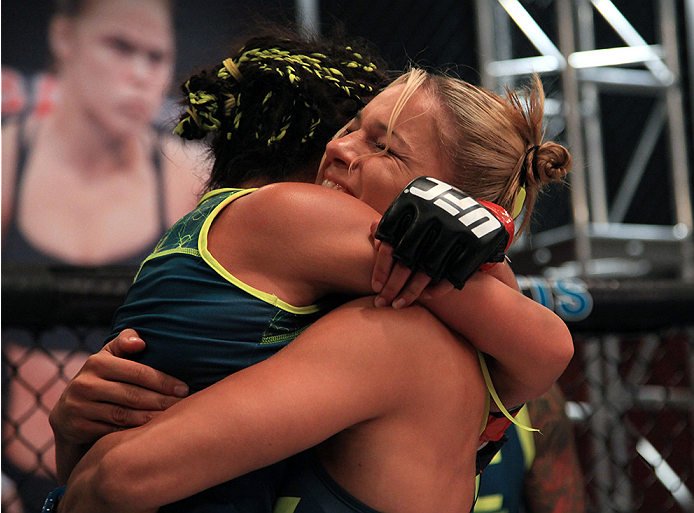 LAS VEGAS, NV - AUGUST 14:  (L-R) Team Pettis fighter Carla Esparza celebrates her win over team Pettis fighter Jessica Penne with Felice Herrig during filming of season twenty of The Ultimate Fighter on August 14, 2014 in Las Vegas, Nevada. (Photo by Bra