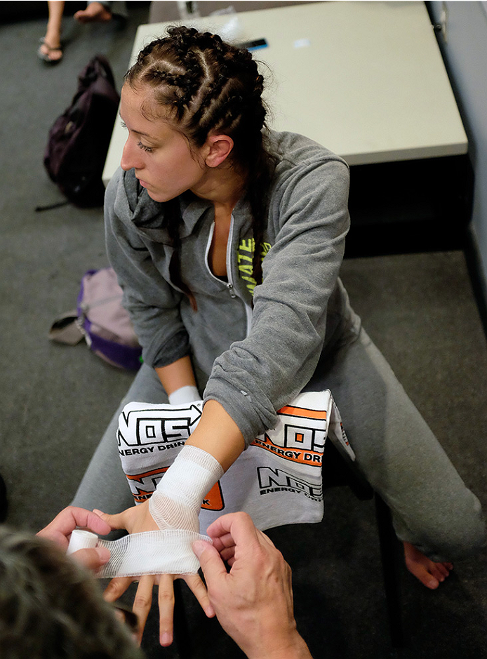 LAS VEGAS, NV - AUGUST 14:  Team Pettis fighter Jessica Penne gets her hands wrapped before facing team Pettis fighter Carla Esparza during filming of season twenty of The Ultimate Fighter on August 14, 2014 in Las Vegas, Nevada. (Photo by Brandon Magnus/