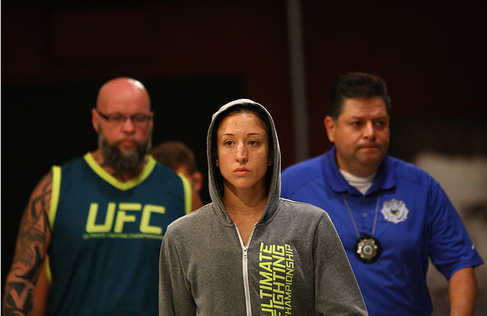 LAS VEGAS, NV - AUGUST 14:  Team Pettis fighter Jessica Penne prepares to enter the octagon before facing team Pettis fighter Carla Esparza during filming of season twenty of The Ultimate Fighter on August 14, 2014 in Las Vegas, Nevada. (Photo by Brandon