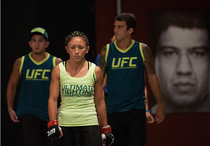 LAS VEGAS, NV - AUGUST 14:  Team Pettis fighter Carla Esparza prepares to enter the Octagon before facing team Pettis fighter Jessica Penne during filming of season twenty of The Ultimate Fighter on August 14, 2014 in Las Vegas, Nevada. (Photo by Brandon
