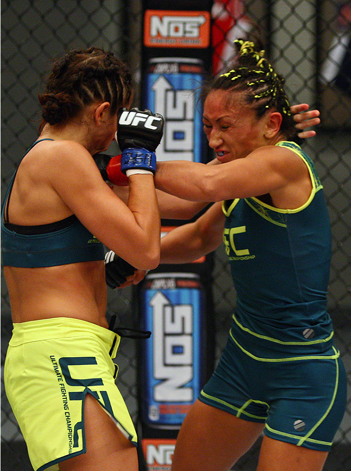 LAS VEGAS, NV - AUGUST 14:  (L-R) Team Pettis fighter Jessica Penne exchanges punches with team Pettis fighter Carla Esparza during filming of season twenty of The Ultimate Fighter on August 14, 2014 in Las Vegas, Nevada. (Photo by Brandon Magnus/Zuffa LL