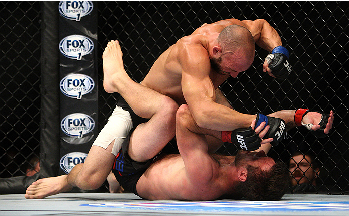 LAS VEGAS, NV - JULY 12:  Trevor Smith (top) punches Dan Miller in their middleweight bout during the Ultimate Fighter Finale inside MGM Grand Garden Arena on July 12, 2015 in Las Vegas, Nevada.  (Photo by Mitch Viquez/Zuffa LLC/Zuffa LLC via Getty Images