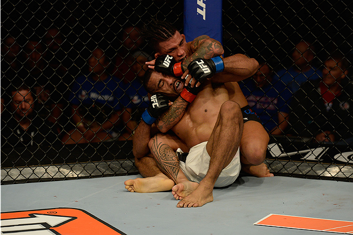 LAS VEGAS, NV - JULY 12:  Russell Doane (top) attempts to submit Jerrod Sanders in their bantamweight bout during the Ultimate Fighter Finale inside MGM Grand Garden Arena on July 12, 2015 in Las Vegas, Nevada.  (Photo by Brandon Magnus/Zuffa LLC/Zuffa LL