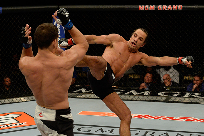 LAS VEGAS, NV - JULY 12:  (R-L) Josh Samman kicks Caio Magalhaes in their middleweight bout during the Ultimate Fighter Finale inside MGM Grand Garden Arena on July 12, 2015 in Las Vegas, Nevada.  (Photo by Brandon Magnus/Zuffa LLC/Zuffa LLC via Getty Ima