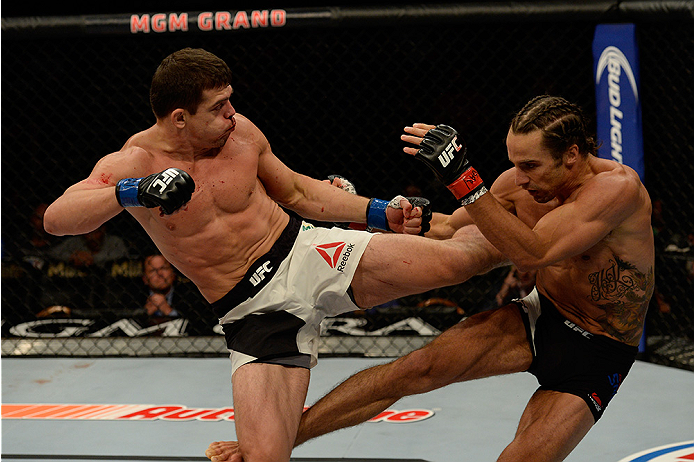 LAS VEGAS, NV - JULY 12:  (L-R) Caio Magalhaes kicks Josh Samman in their middleweight bout during the Ultimate Fighter Finale inside MGM Grand Garden Arena on July 12, 2015 in Las Vegas, Nevada.  (Photo by Brandon Magnus/Zuffa LLC/Zuffa LLC via Getty Ima