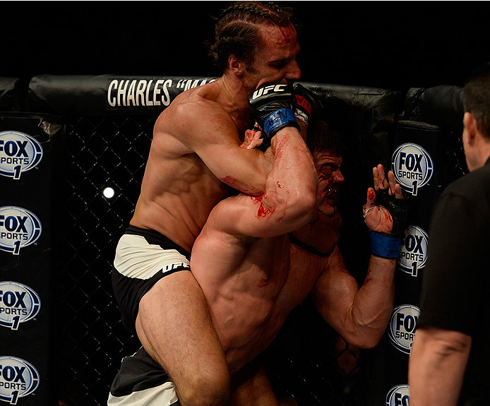 LAS VEGAS, NV - JULY 12:  (L-R) Josh Samman attempts a rear naked choke on Caio Magalhaes in their middleweight bout during the Ultimate Fighter Finale inside MGM Grand Garden Arena on July 12, 2015 in Las Vegas, Nevada.  (Photo by Brandon Magnus/Zuffa LL