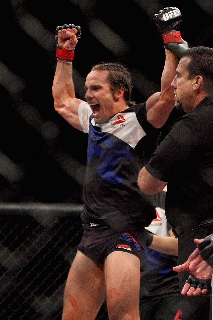 LAS VEGAS, NV - JULY 12:  Josh Samman celebrates his win over Caio Magalhaes in their middleweight bout during the Ultimate Fighter Finale inside MGM Grand Garden Arena on July 12, 2015 in Las Vegas, Nevada.  (Photo by Mitch Viquez/Zuffa LLC/Zuffa LLC via