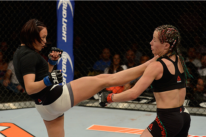 LAS VEGAS, NV - JULY 12:  (L-R) Michelle Waterson kicks Angela Magana in their women's strawweight bout during the Ultimate Fighter Finale inside MGM Grand Garden Arena on July 12, 2015 in Las Vegas, Nevada.  (Photo by Brandon Magnus/Zuffa LLC/Zuffa LLC v
