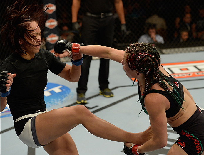 LAS VEGAS, NV - JULY 12:  (R-L) Angela Magana punches Michelle Waterson in their women's strawweight bout during the Ultimate Fighter Finale inside MGM Grand Garden Arena on July 12, 2015 in Las Vegas, Nevada.  (Photo by Brandon Magnus/Zuffa LLC/Zuffa LLC