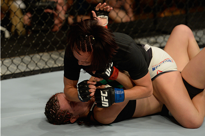 LAS VEGAS, NV - JULY 12:  Michelle Waterson (top) elbows Angela Magana in their women's strawweight bout during the Ultimate Fighter Finale inside MGM Grand Garden Arena on July 12, 2015 in Las Vegas, Nevada.  (Photo by Brandon Magnus/Zuffa LLC/Zuffa LLC