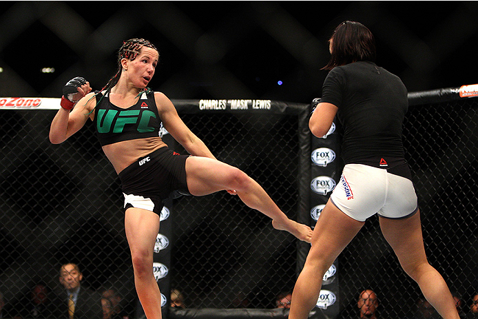 LAS VEGAS, NV - JULY 12:  (L-R) Angela Magana kicks Michelle Waterson in their women's strawweight bout during the Ultimate Fighter Finale inside MGM Grand Garden Arena on July 12, 2015 in Las Vegas, Nevada.  (Photo by Mitch Viquez/Zuffa LLC/Zuffa LLC via