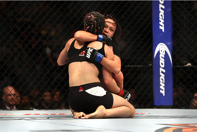 LAS VEGAS, NV - JULY 12:  Angela Magana (front) and Michelle Waterson embrace after their women's strawweight bout during the Ultimate Fighter Finale inside MGM Grand Garden Arena on July 12, 2015 in Las Vegas, Nevada.  (Photo by Mitch Viquez/Zuffa LLC/Zu