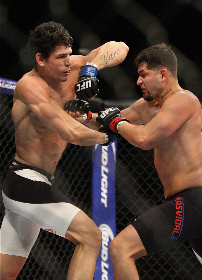 LAS VEGAS, NV - JULY 12:  (L-R) Cezar Ferreira elbows Jorge Masvidal in their welterweight bout during the Ultimate Fighter Finale inside MGM Grand Garden Arena on July 12, 2015 in Las Vegas, Nevada.  (Photo by Mitch Viquez/Zuffa LLC/Zuffa LLC via Getty I