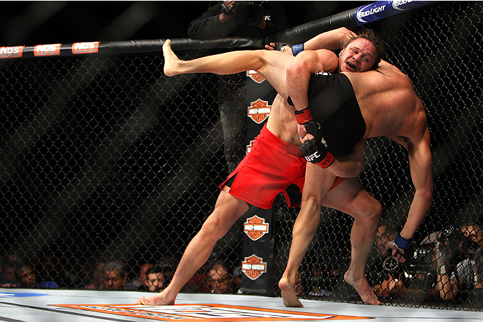 LAS VEGAS, NV - JULY 12:  (L-R) Michael Graves attempts to take down Vicente Luque in their welterweight bout during the Ultimate Fighter Finale inside MGM Grand Garden Arena on July 12, 2015 in Las Vegas, Nevada.  (Photo by Mitch Viquez/Zuffa LLC/Zuffa L