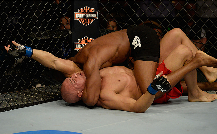 LAS VEGAS, NV - JULY 12:  Kamaru Usman (top) attempts to submit Hayder Hassan in their welterweight bout during the Ultimate Fighter Finale inside MGM Grand Garden Arena on July 12, 2015 in Las Vegas, Nevada.  (Photo by Brandon Magnus/Zuffa LLC/Zuffa LLC