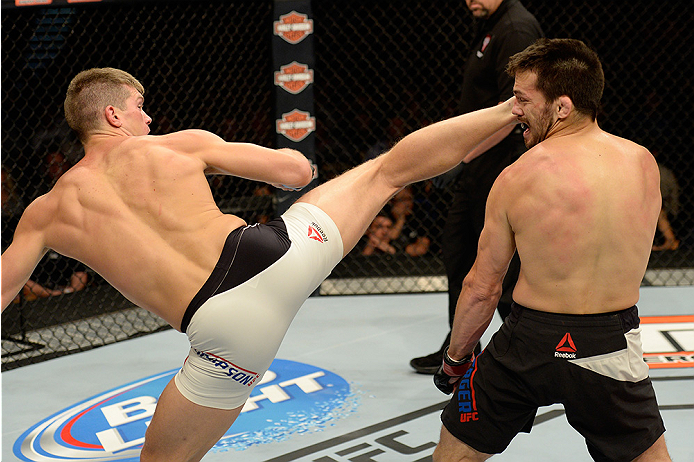 LAS VEGAS, NV - JULY 12:  (L-R) Stephen Thompson kicks Jake Ellenberger in their welterweight bout during the Ultimate Fighter Finale inside MGM Grand Garden Arena on July 12, 2015 in Las Vegas, Nevada.  (Photo by Brandon Magnus/Zuffa LLC/Zuffa LLC via Ge