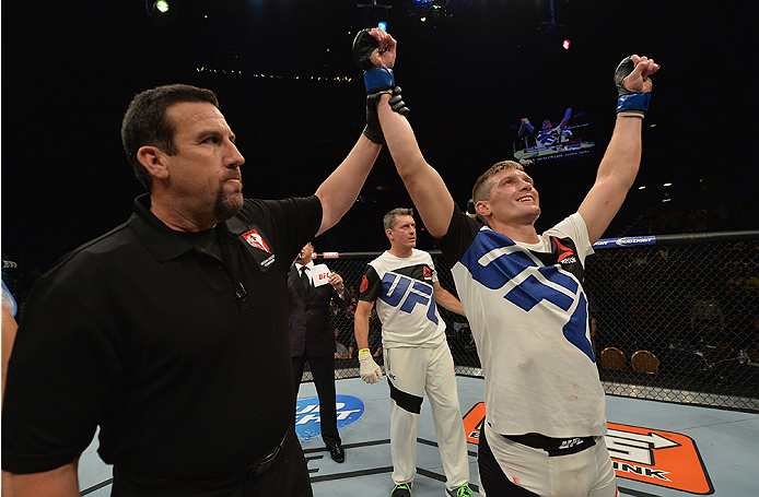 LAS VEGAS, NV - JULY 12:  Stephen Thompson (right) reacts to his victory over Jake Ellenberger in their welterweight bout during the Ultimate Fighter Finale inside MGM Grand Garden Arena on July 12, 2015 in Las Vegas, Nevada.  (Photo by Brandon Magnus/Zuf