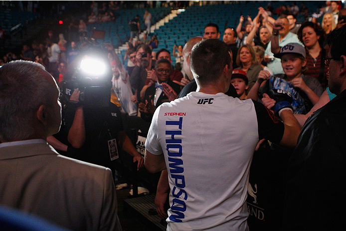 LAS VEGAS, NV - JULY 12:  Stephen Thompson celebrates with fans after defeating Jake Ellenberger in their welterweight bout during the Ultimate Fighter Finale inside MGM Grand Garden Arena on July 12, 2015 in Las Vegas, Nevada.  (Photo by Mitch Viquez/Zuf
