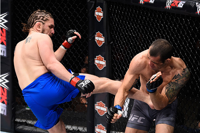 LAS VEGAS, NV - DECEMBER 11: (L-R) Chris Gruetzemacher kicks Abner Lloveras in their lightweight bout during the TUF Finale event inside The Chelsea at The Cosmopolitan of Las Vegas on December 11, 2015 in Las Vegas, Nevada.  (Photo by Jeff Bottari/Zuffa