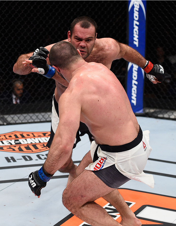 LAS VEGAS, NV - DECEMBER 11: Gabriel Gonzaga (top) punches Konstantin Erokhin  in their heavyweight bout during the TUF Finale event inside The Chelsea at The Cosmopolitan of Las Vegas on December 11, 2015 in Las Vegas, Nevada.  (Photo by Jeff Bottari/Zuf